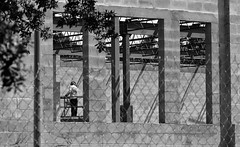 Building (Twila1313) Tags: flickrfriday building monochrome construction worker man block concrete scaffold blackandwhite sonynex5n minoltarokkor135mmf35
