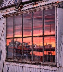 """""""Hard to look inside"""" (Vest der ute) Tags: norway window boat boats reflections wiindow sky clouds sunset cranes quay hall evening summer fav25 fav200"""