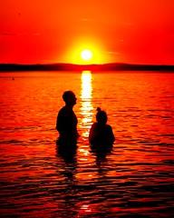 Midnigth swim in the midnigth sun. (jyrkijnieminen) Tags: sunset romance lake lakeview