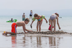 Serious Work at the Bear Lake Beach (aaronrhawkins) Tags: children boy girl cousins beach swim swimming suit bearlake vacation kids play sand build joshua clara vivian bucket hole castle dirt reflection water recreation idaho family reunion aaronhawkins
