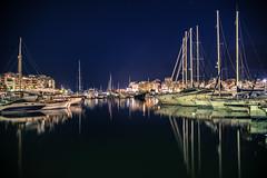 DSC_2479 (athanecon) Tags: sea boats masts night lights citylights piraeus pasalimani greece reflections