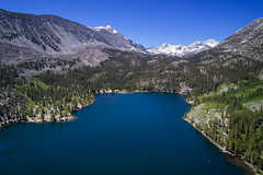 Rock Creek Lake (Bryan the Roving Vagabond) Tags: rockcreeklake sierranevada sierras lake landscape mountains snow water trees drone dji djiphantom4 phantom4 sky june california easternsierra tree wood boat forest mountainside mountain