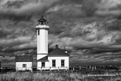 Point Wilson Lighthouse, Seattle Washington (garofano_richard) Tags: fence buildings rocks dynamicclouds observationdeck fortwordenstatepark porttownsend stateofwashington seattle