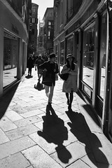 Shadows (G Reeves) Tags: nikon nikond810 garyreeves streetphotography street people life men women man woman workers bw blackwhite blackandwhite monochrome venice italy europe shadow outside urban landscapes urbanlandscapes town city metropolis outdoor shops