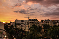 Parisian glow (Anthony P.26) Tags: category citiestowns france hotelbaldi paris places street sunset travel streetphotography cityscape cityscene cambronne glow sun railway residential europe bridge canon1585mm canon550d canon outdoor clouds sky cloudy eiffeltower