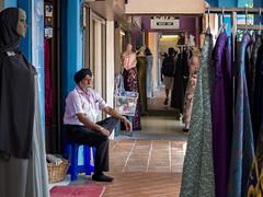 Solitude: Watcher (thecrapone) Tags: solitude peace shopping shopkeeper waiting arabstreet chothing store brickandmotar singapore