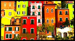 Recovered Innocence (Loegan Magic) Tags: secondlife kekeland bardeco apartments villas homes colorful windows fireescapes doors crowded trees italianvilla bright