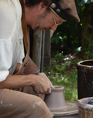 Corvus Moon Pottery (Adventurer Dustin Holmes) Tags: 2018 whitehart renaissancefair renaissancefaire renaissancefestival event events hartvillemo hartvillemissouri wrightcounty ozarks corvusmoonpottery pottery clay potterswheel potterywheel