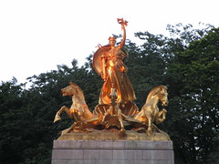 Orange Sunset Victory Statue - USS Maine Monument 4239 (Brechtbug) Tags: orange sunset victory statue maine monument 1914 beaux arts commemorating sinking battleship 1898 sculpted representations mythological figures peace courage fortitude justice central park entrance nyc 06252018 new york city statues group sculpture sculptures art golden gold leaf woman horses hippocampus seahorse hippocamp sea horse giant clam shell sled coach chariot mythology columbus circle architect h van buren magonigle sculptor attilio piccirilli 1901 1913