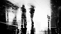 Come on, get moving! (明遊快) Tags: monochrome rain people reflections japanese urban street contrast