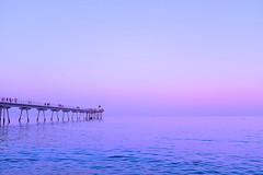 The pink hour: Between sunset and nightfall (Fnikos) Tags: sea water seascape mar mare serene boat dark light bridge pier puente pont construction blue sky skyline pink people walk bay outdoor