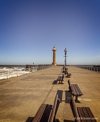 Whitby pier. (jack cousin) Tags: whitby yorkshire uk northsea seascape town coast shore seashore harbour harbor port sea water tourism travel touristattraction resort holiday vacation popular outdoor nature seat bench quay railing nikond610 on1photos lighthouse lamppost