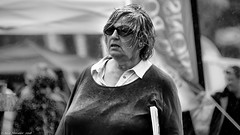 And she brings the wind with her (Neil. Moralee) Tags: middevonshow2018neilmoralee neilmoralee woman lady rain wet mature old galsses wind weather damp soaking soaked upset disapointed devon show mid neil moralee nikon d7200 black white bw bandw mono monochrome blackandwhite england britain shower pouring catsanddogs summer