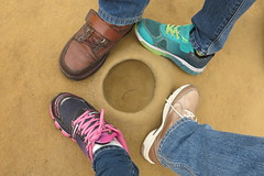 I love my family (沐均青) Tags: 台灣 taiwan 野柳 風景 scenery colorful feet summer shoes green yellow landscape beach water rock circle hole nature blue sea people family love white four gold brown jeans