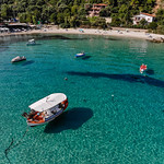 Drone photo of boats near the beach in Afitos, Chalkidiki thumbnail
