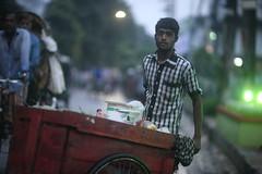 MANGOED ! (N A Y E E M) Tags: seller vendor hawker mango cart candid colors light dusk evening street norahmedroad chittagong bangladesh carwindow sooc raw unedited untouched