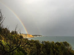 Rainbow @ Black Rock - appeared on ABC TV, 13 August, 2018 (Marian Pollock) Tags: australia melbourne blackrock rainbow cliffs sky sun overcast bushes sea portphillipbay bay waterscape sunshine clouds cerebrus ocean rain weather wreck shore seascape