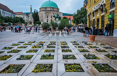 2018 - Hungary - Pécs - Széchenyi Square (Ted's photos - For Me & You) Tags: 2018 cropped hungary nikon nikond750 nikonfx pécs tedmcgrath tedsphotos vignetting pécshungary pecshungary széchenyisquare pecsszéchenyisquare széchenyisquarepecs pécsszéchenyisquare ottomangazikhassimmosque fountain waterfountain streetscene street people peopleandpaths pathsandpeople sculpture bronzesculpture flowers backpack church dome churchdome