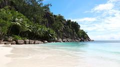 Petite Anse... (John Konstandis) Tags: canoneos5dmarkiii canonef24105mmf4lisusm seychelles mahe sky sea seacoast water blue green tropic sand beach petiteanse