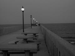 Pier at Dusk (Shawn Blanchard) Tags: wrightsville beach sea light black white bw blackandwhite pier bench water north carolina nc sky