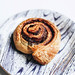 Close up of delicious cinnamon roll in a printed plate.jpg