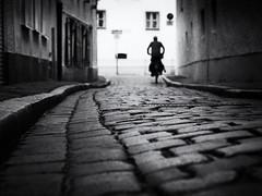 lonely biker (Sandy...J) Tags: urban noir atmosphere alone atmosphäre altstadt oldtown olympus light darkness silhouette biker blackwhite bw blur blurred cobblestones city street streetphotography sw schwarzweis strasenfotografie stadt monochrom mono germany deutschland gegenlicht backlight