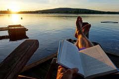 Summertime and the livin' is easy (brittajohansson) Tags: lake sunset evening water lanscape waterscape book reading silent serene sun summertime