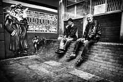 Auld Dubliner (Kieron Ellis) Tags: man men sitting drinking smoking hat wall painting corner windows bag street candid blackandwhite blackwhite monochrome