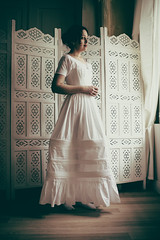 IMG_13848 (saver_ag) Tags: people portrait female indoor underwear white vintage historicaldress profile