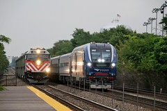 Westbound Illinois Zephyr with Charger in the lead passes westbound local (kschmidt626) Tags: metra chicago hinsdale f40ph new repaint burlington train illinois zephyr