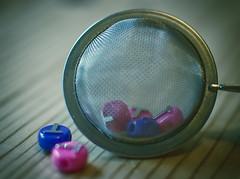 "T-Strainer - Macro Mondays ""Mesh"" (iratebadger) Tags: nikon nikond7100 d7100 depthoffield dof mesh macromonday beads t teastrainer metal pink purple wood blue blur indoors f18 35mm nikkor iratebadger"