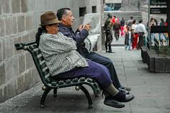 (pedro katz) Tags: quito man woman reading people bench shoes hat newspaper nikon d70