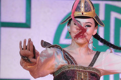 Tassel Interference (peterkelly) Tags: digital canon 6d asia gadventures transmongolianadventure mongolia ulaanbaatar nationalrecreationcenter mongoliannationalsongdanceensemble tumenekh woman hat tassel dancing dancer