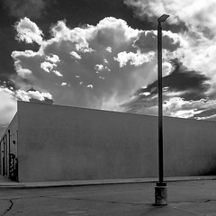 (el zopilote) Tags: albuquerque newmexico cityscape architecture street clouds signs storefronts iphone apple bw bn nb blancoynegro blackwhite noiretblanc digitalbw bndigital fullframe schwarzweiss monochrome