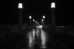 (cherco) Tags: night noche woman mujer light luz zaragoza bridge composition composicion canon city ciudad chica calle solitario solitary silhouette silueta street shadows sombra shadow sombras lonely alone rain lluvia umbrella paraguas reflejos reflexions arquitectura architecture mojado blackandwhite blancoynegro black monochrome urban eos canoneos5diii