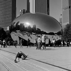 take a nap (doistrakh) Tags: chicago illinois cloudgate millenniumpark usa unitedstates travel america tlr twinlensreflex rolleiflex rolleiflex35e mediumformat vintageanalogue vintagecamera 120camera 120film 6x6 square film monochrome bw blackandwhite city cityscape reflection fujifilm neopan acros100