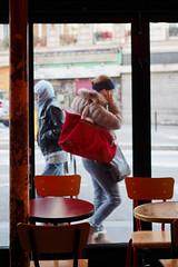 La fille au sac rouge à Château Rouge - La vie est un film en photo (Paolo Pizzimenti) Tags: rouge gris pluie vitrine fille table café cinéma couple bretagne paolo paris olympus omdem1mkii zuiko25mm f18 film pellicule argentique m43mirrorless