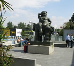Madrid Colours - HappY Botero Bench Monday ! (Pushapoze (NMP)) Tags: spain madrid airport sculpture botero happybenchmonday bench luggage suitcases people sky blue clouds