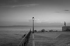 Enjoying the sea (tzevang.com) Tags: sea seascape enjoy greece bw bythesea bwseascape evening athens melancholic