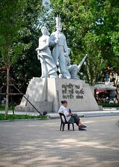 Statue Sitter (Mondmann) Tags: statue monument sitting sitter woman vietnamese vietnamesewoman hanoi vietnam asia southeastasia warmonument streetphotography travel mondmann fujifilmxt10