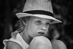 Happy with the new hat 2 (PascallacsaP) Tags: girl hat glad happy new braid freckles blackandwhite monochrome bw portrait