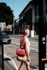 Out of focus and out of step. Brave man. (ianmiller6771) Tags: streetphotography streetphotographyuk courageous courage brave bravery colourstreet fujixt1 fuji 35mm transgender worcesteruk pinkhandbag crossdressing bottle