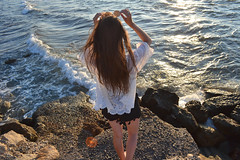 Sea... sun... summer! (Maria Godfrida) Tags: 7dwf crazytuesdaytheme summer season summertime sea water waves blue sun sunshine portrait backside hair long rocks bokeh sparkling shining ocean psp