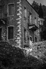 The art of old [in explore] (Kostis Tatakis) Tags: blackandwhite bw blackwhite monochrome store stonewall building oldbuilding traditional masonry windows gythio gythion mani peloponnese peloponnesus greece nikond7200