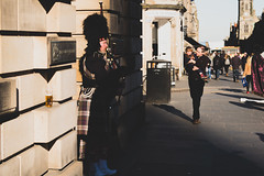 Lone Piper (@stegreener) Tags: scotland piper edinburgh streetphotography street pentax pentaxk1 shadow doorway pint beer child man beaver bin sun sunlight pavement church people kilt scottish