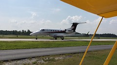 Embraer Phenom 300 | Business Jet on Taxiway | DeKalb Peachtree Airport (steveartist) Tags: jetaircraft embraerphenom300 taxiway pdk sketchclub lumixlx100 snapseed biplanewing woods treesrunway stevefrenkel businessjet clouds