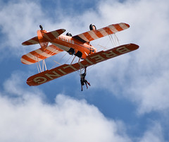 Hangtime (simmonsphotography) Tags: shuttleworth oldwarden bedfordshire airshow aircraft aeroplane airplane boeing stearman superstearman wingwalker wingwalkers aerobatic aerobatics aerosuperbatics flyingcircus breitling n49943 cloud