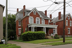 House — Lexington, Kentucky (Pythaglio) Tags: house dwelling residence historic twostory brick classicalrevival latevictorian queenanne lexington fayettecounty ca1900 11windows shutters stone lintels sills cornicereturns dentils chimneys porch ionic columns capitals bushes trees utilitypoles driveway street wires cables