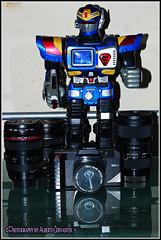 AQUELLOS TIEMPOS ERA UN HOBBY. THOSE TIMES WAS A HOBBY. GUAYAQUIL - ECUADOR (ALBERTO CERVANTES PHOTOGRAPHY) Tags: thosetimeswasahobby robot lente lentes lens lenses camara camera power canonwr1 canon wr1 wr camarafotografica photographiccamera cinecamera guayaquil ecuador ecuadorguayaquil republicadelecuador gye ecuadorgye indoor outdoor blur reflejo reflection retrato portrait photography photoborder luz light color colores colors brightcolors brillo bright sign writing newcoloropticallens hobby doll ngc historia history