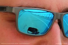 Reviewing the shot (srkirad) Tags: reflection glasses sunglasses promenade walkway river sava belgrade beograd serbia srbija camera travel face closeup sunny
